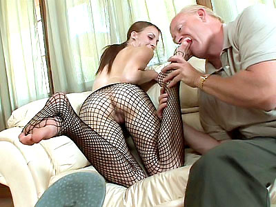 Sassy redhead vixen Jordan Minor comes jumping into the set in sexy black lingerie and fishnets She starts off by warming up her pussy using her fingers while a horny guy admires her pretty feet The guy took out his dick and jams it between Jordans feet